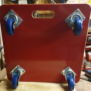 Relocation Skate 600 x 600 x 18mm, Rubber Topped, LargeCarryHandle,100mm Blue Rubber Castors, Red uPVC Covered Base and Colour Self Adhesive Logo